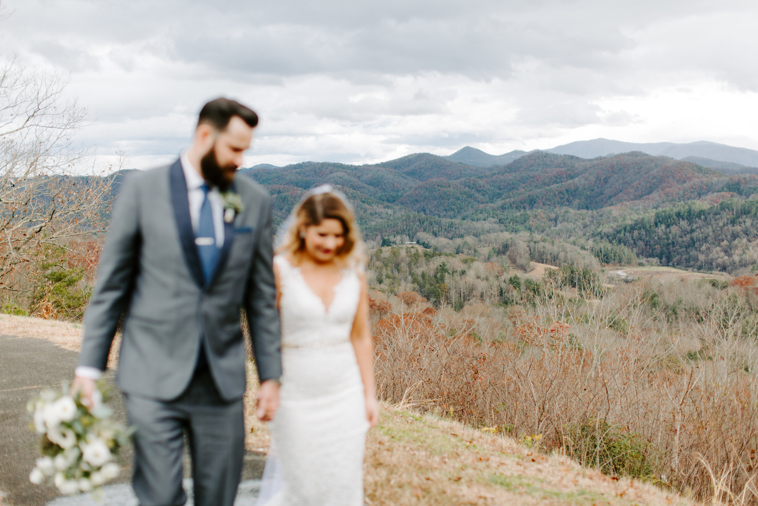 bride and groom first look in the mountains