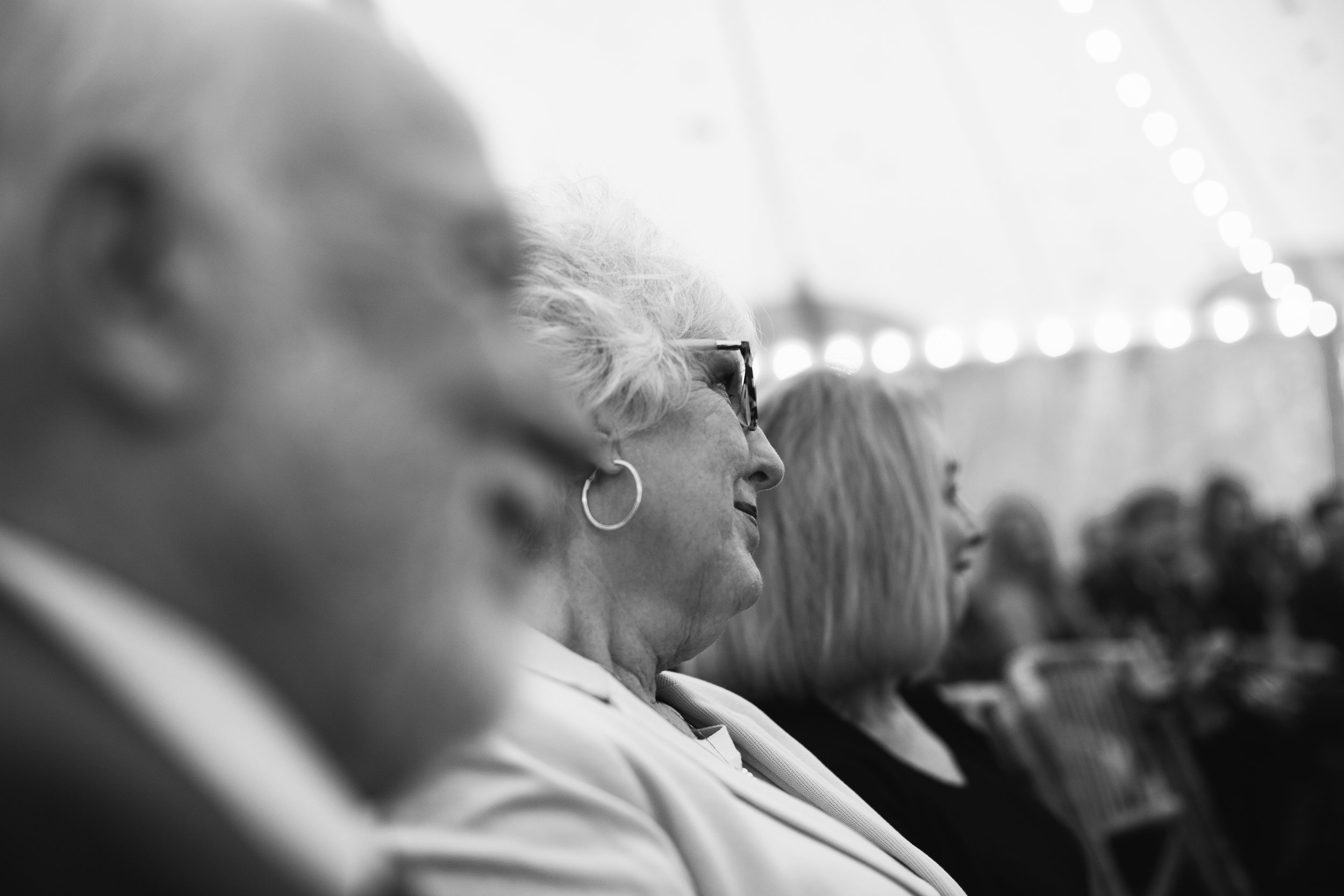 grandmother watching wedding ceremony