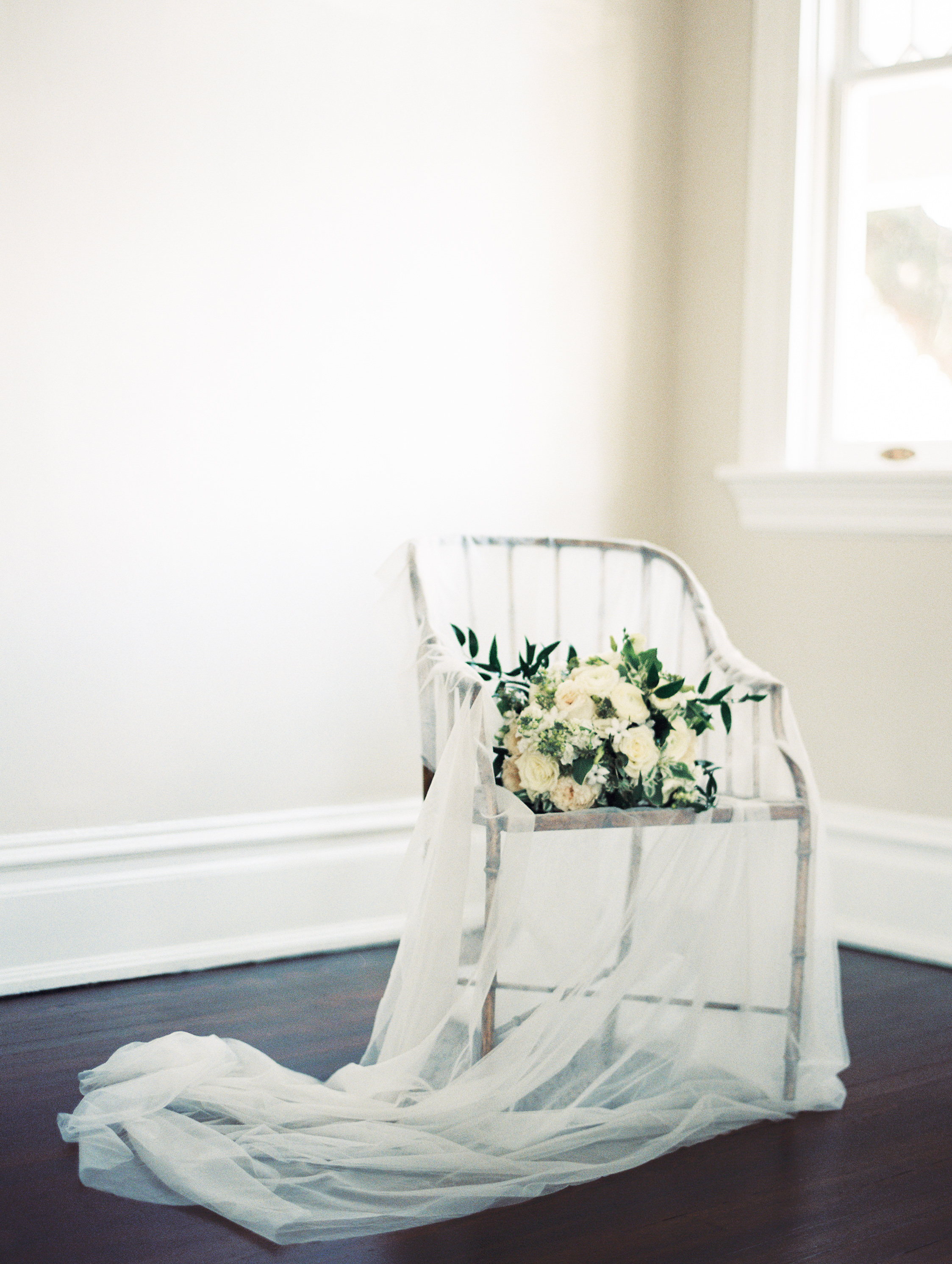 wedding bouquet in chair with veil