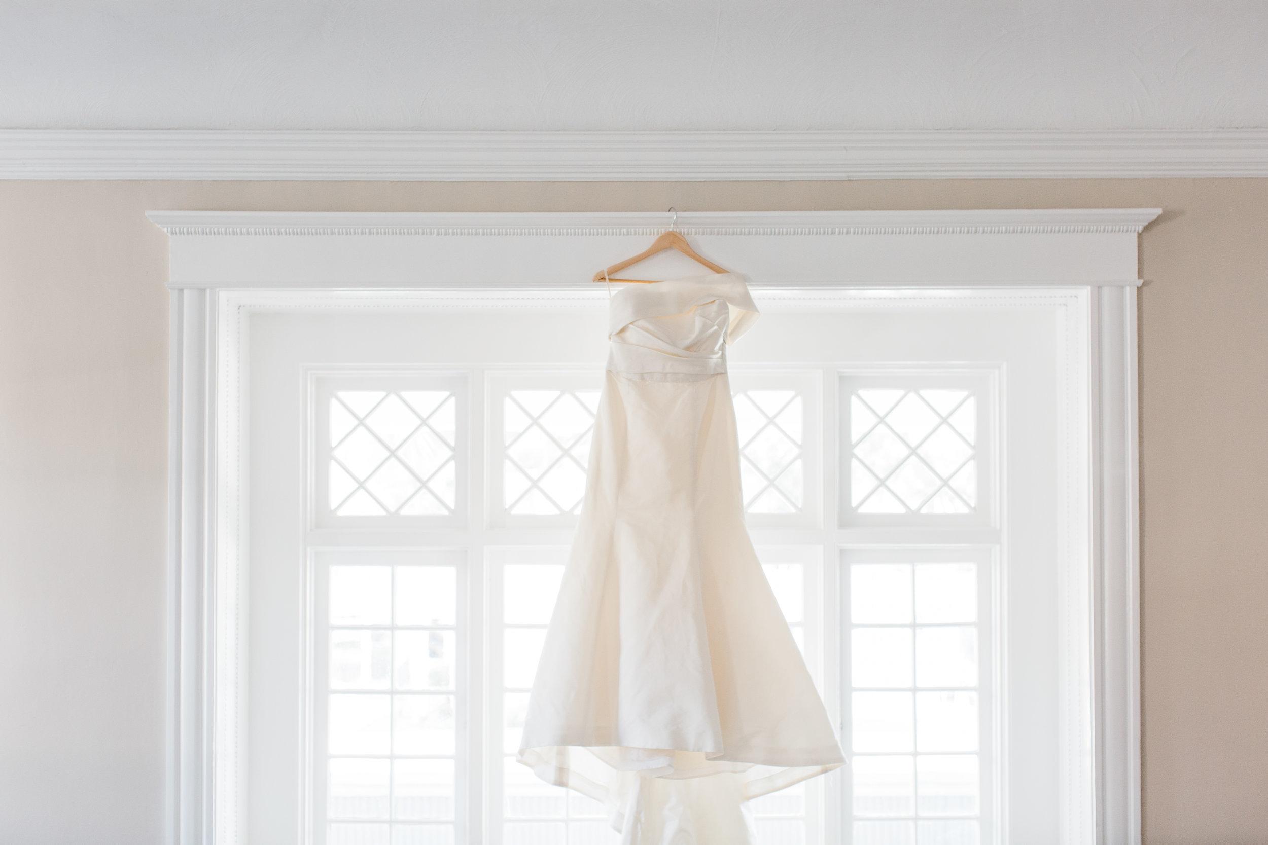 amsale wedding dress hanging