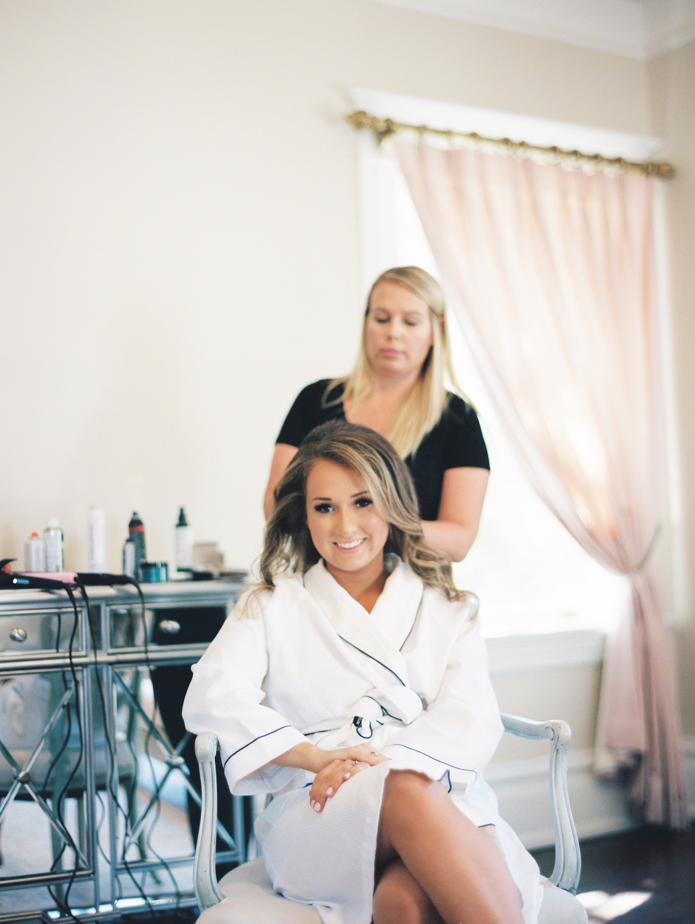 bride getting ready with style and hair makeup