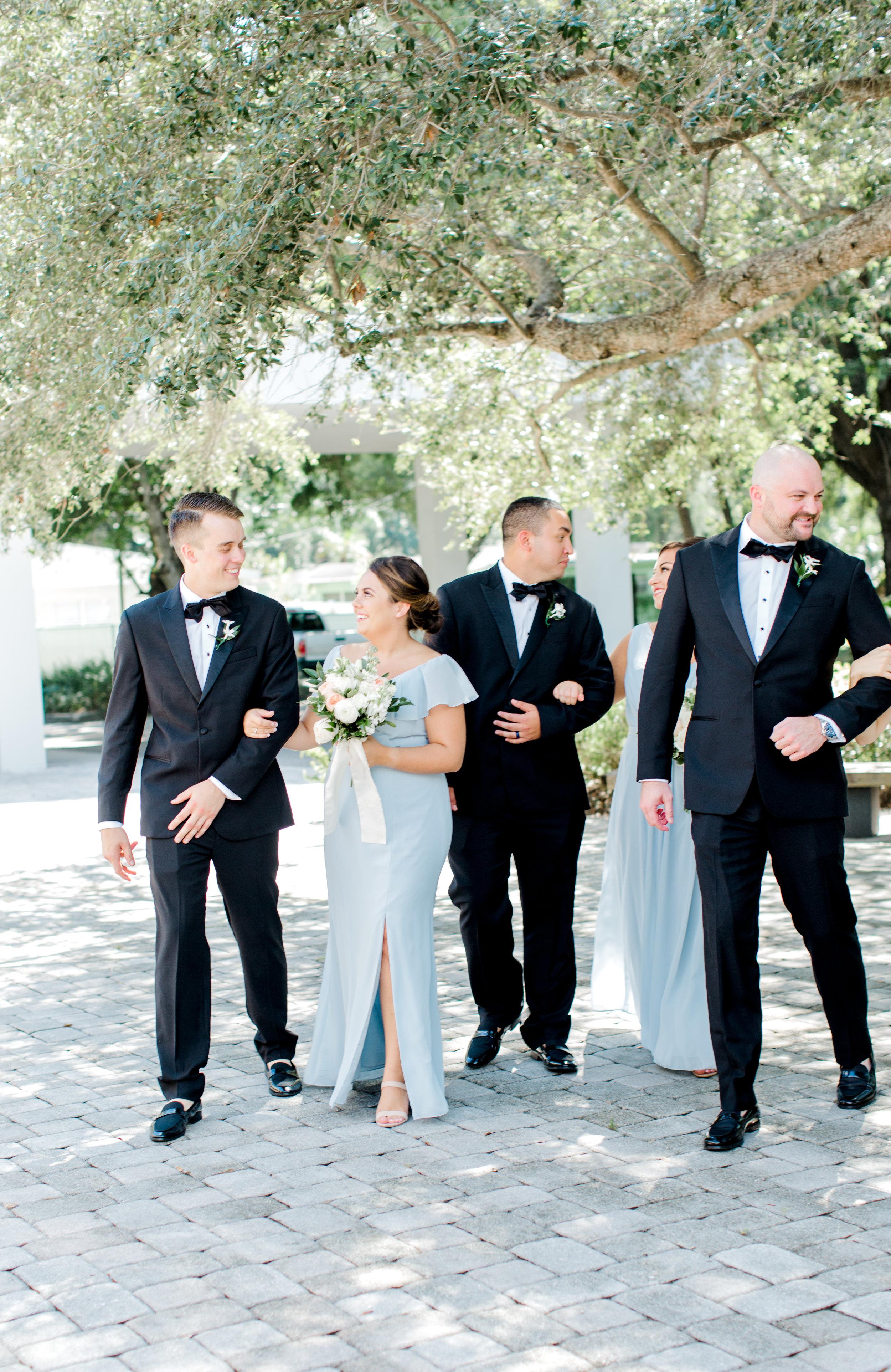 candid wedding party walking
