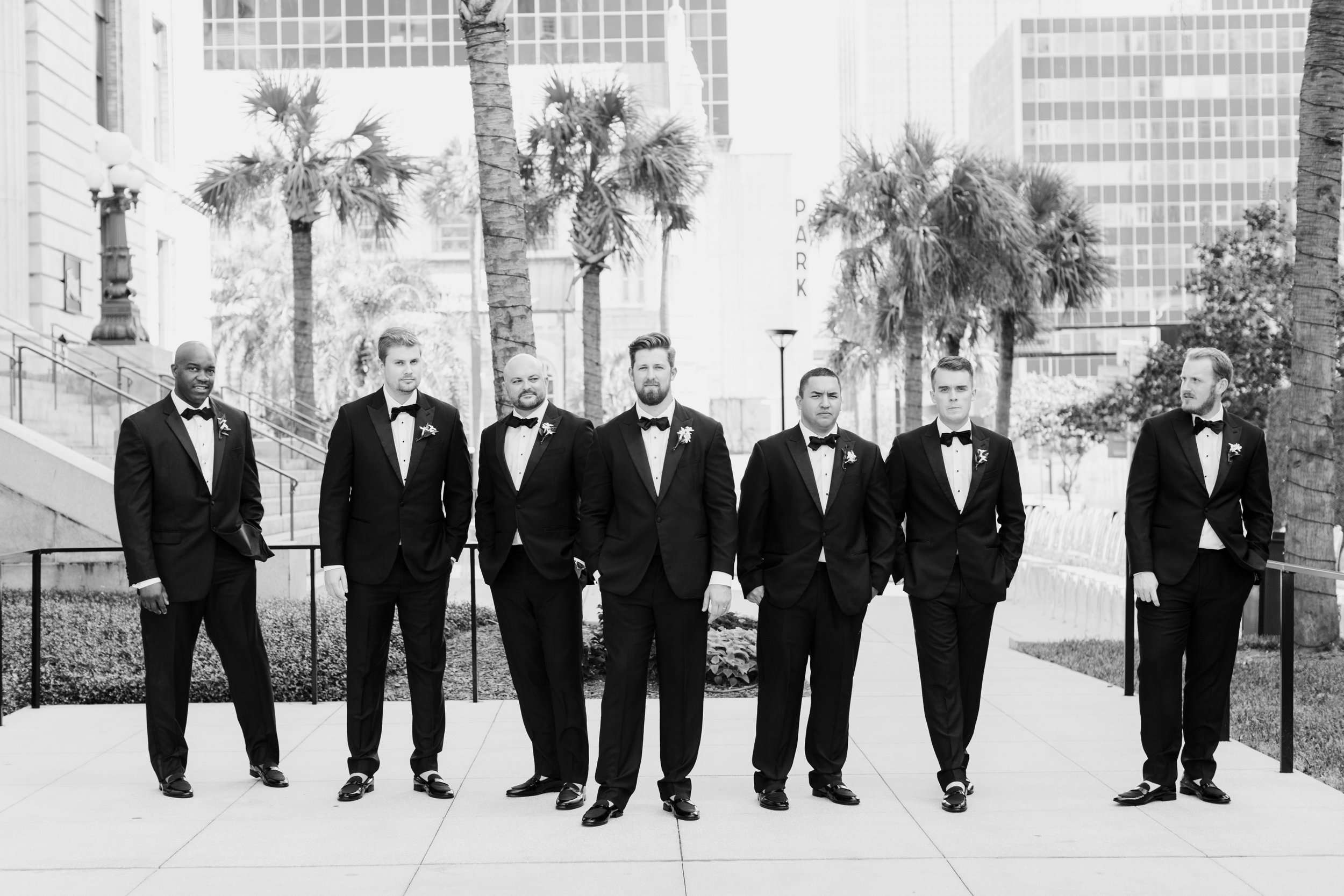 groomsmen in black and white in downtown tampa