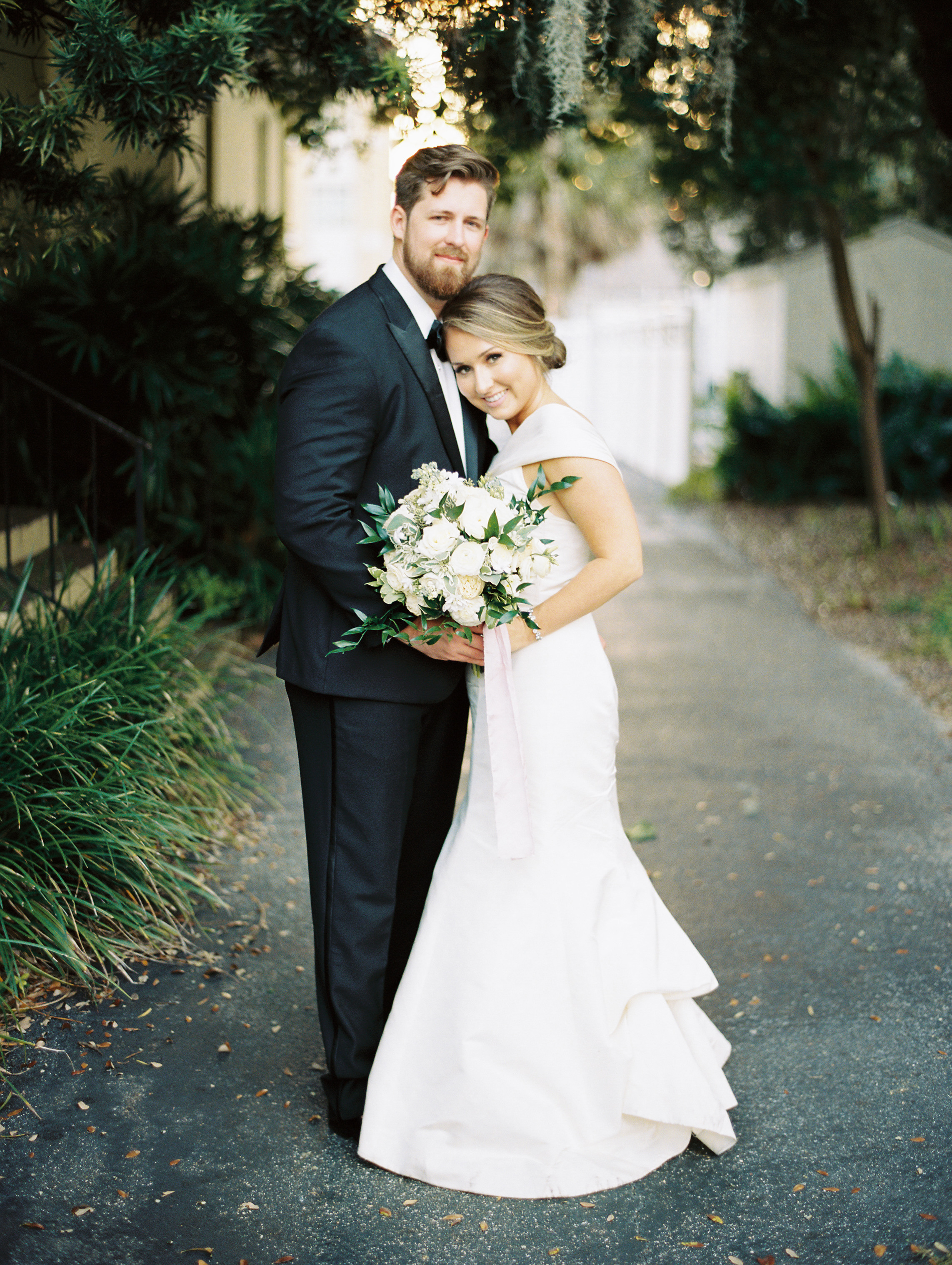 classic bride and groom with flowers general bouquet