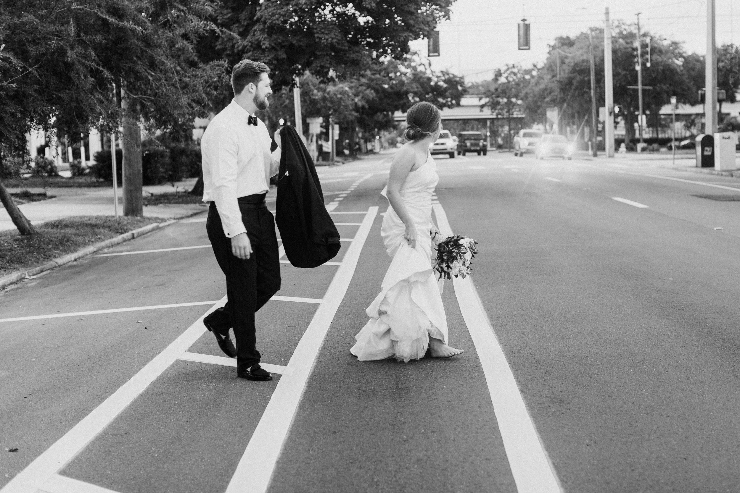barefoot bride crossing the street