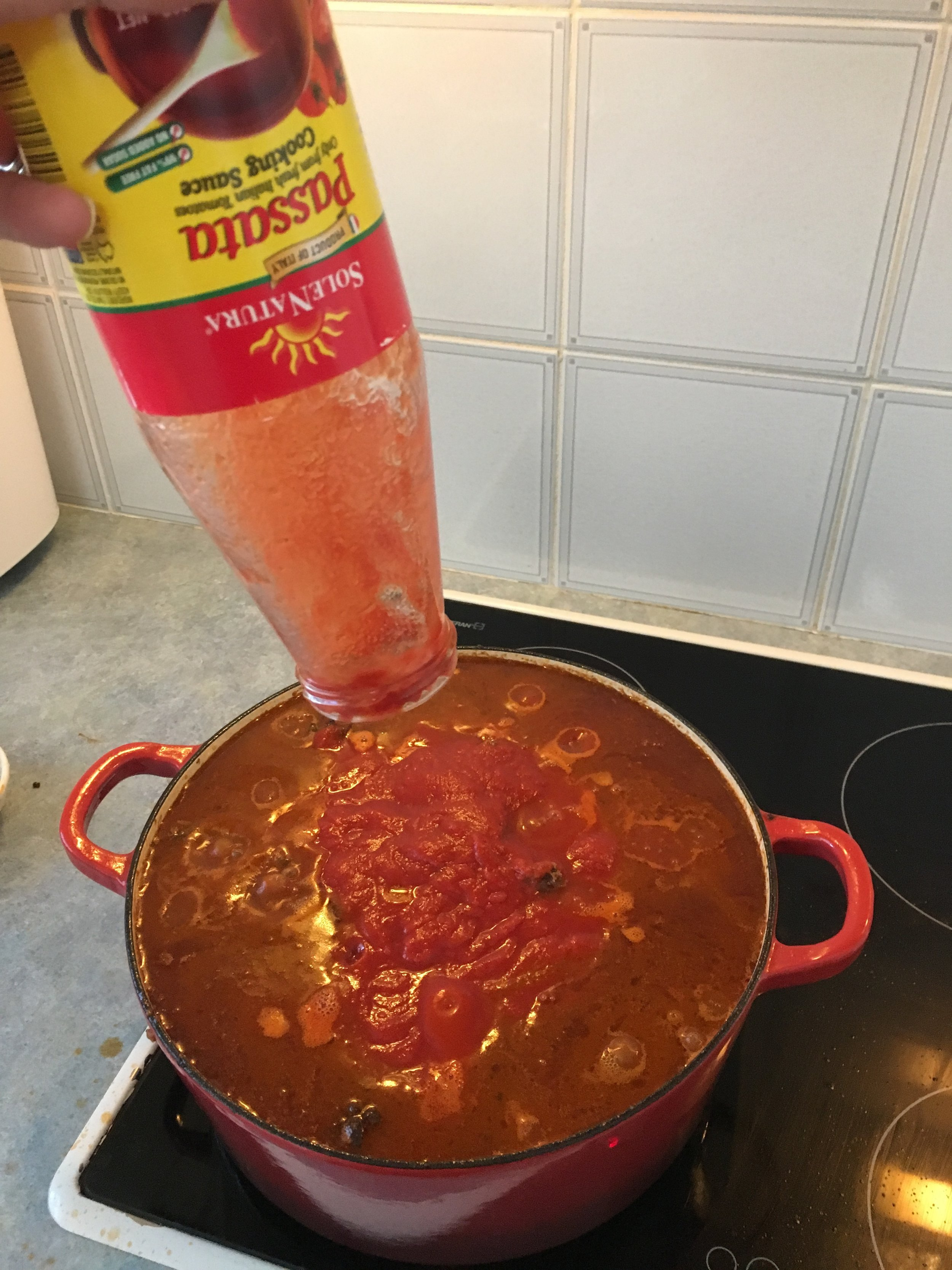 Victory! After several hours of simmering and reducing, the last of the passata fits in the pot.