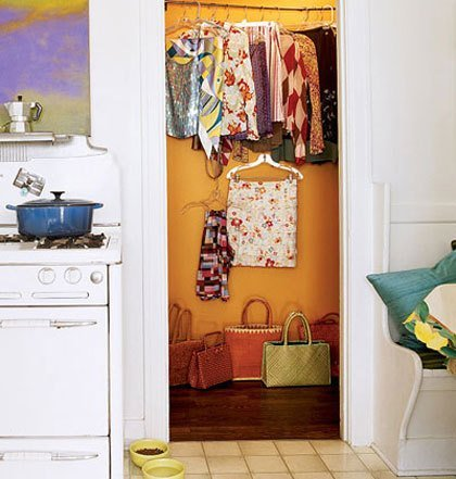 Yes! Small closets need love too! This orange is a bright blast of uplifting color. (Photo Credit: Cottage Living)