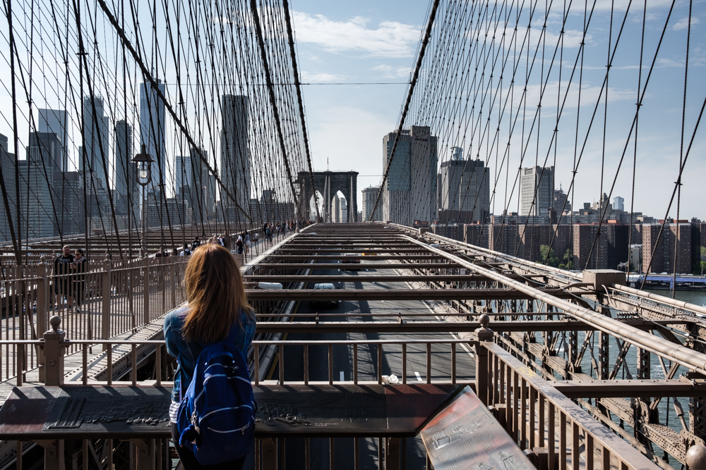 New York City Street Photography Brooklyn Bridge Girl Write Lighting.jpg