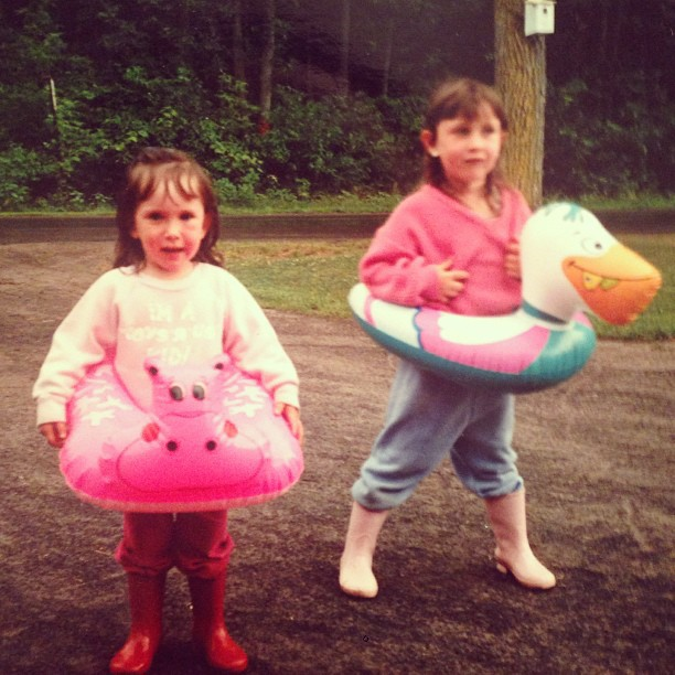 That's me, wearing the pelican inner-tube in the driveway. I was, in no small way, obsessed with those pink rain boots.
