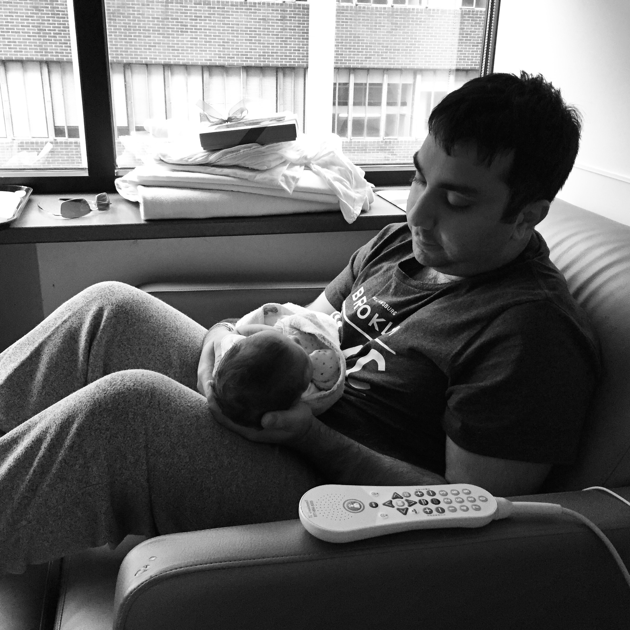 Two days old, just catching up on life with Daddy.