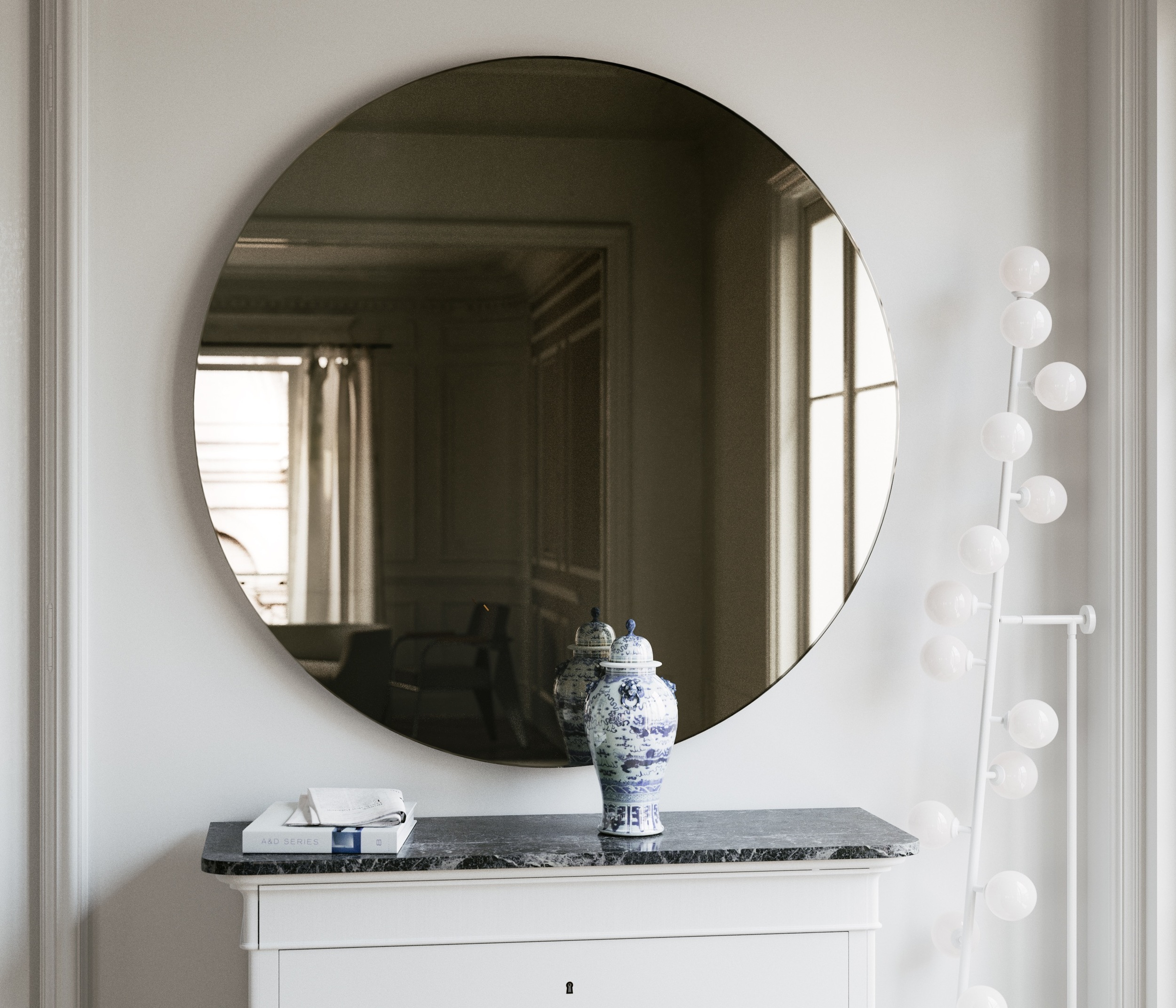 Front facing photo of dark gold Art Deco mirror