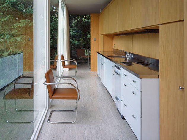 Different materials are used on different planes at the Farnsworth House. Mies breaks the rule with the travertine pavers rising vertically as the backstop for the fireplace and millwork core.