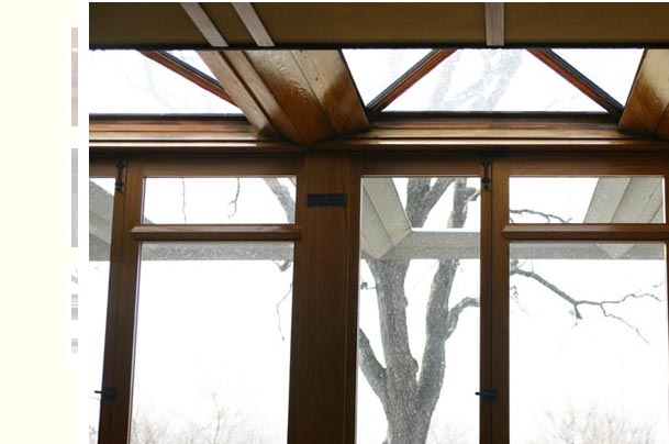 View of the trellis from the interior of the house. Wright creates an inside/outside volume with the cypress beams.