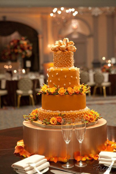 Wedding cake on gold cake stand