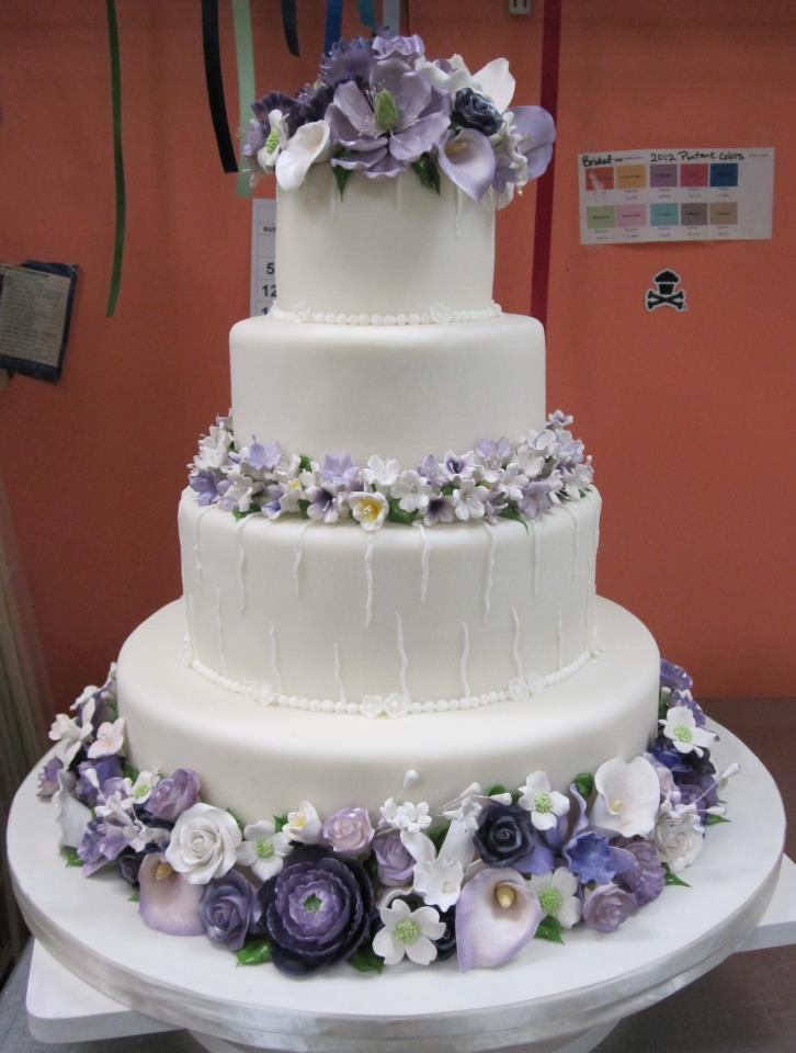 Wedding Cakewith purple flowers