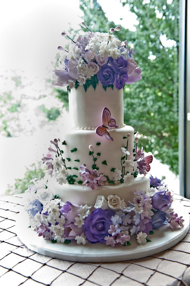 Elaborate Wedding Cake with Purple Flowers