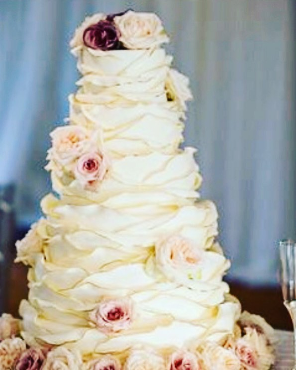 Getting all sorts of warm wintery feels from the extra ruffled gold trimmed cake with shades of pink and mauve.  #weddingcake #ruffledcake #cake #dmvcakes #wedding #pinkroses #instacake #fondantcake #fancycakesbakery #bethesda #washingtondc