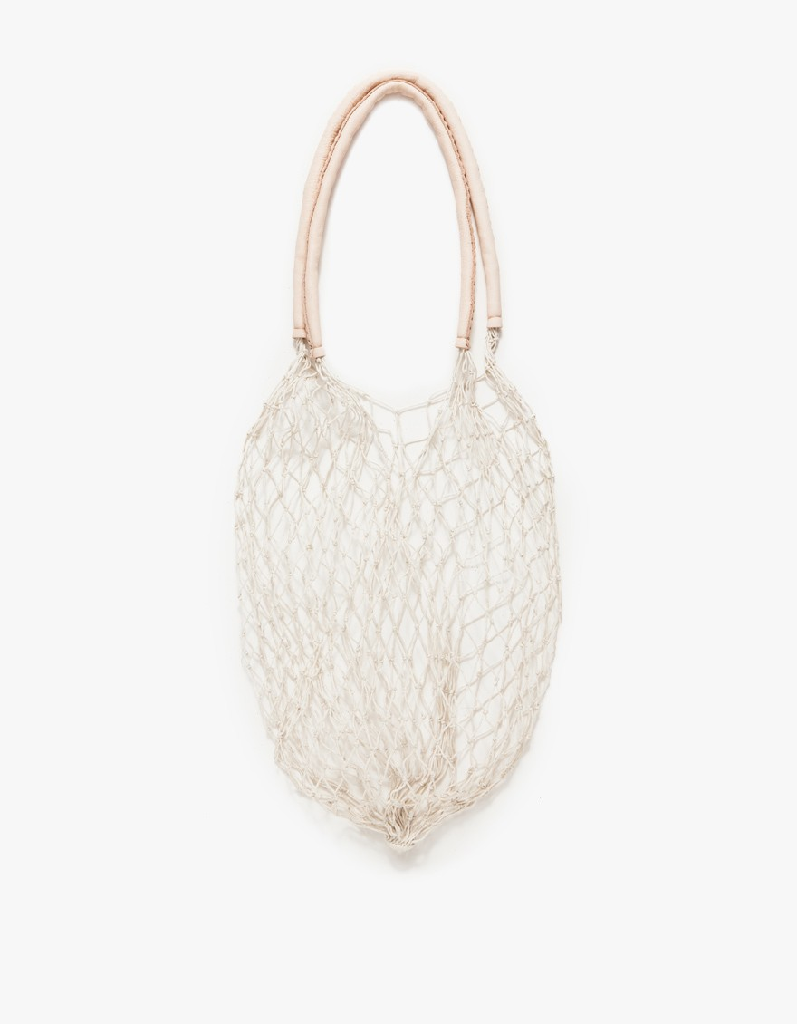 Simple and low-key cotton cord white net bag with soft, vegetable tanned leather handles from And So It Goes. Handcrafted one knot at a time in Los Angeles.  AND SO IT GOES $85