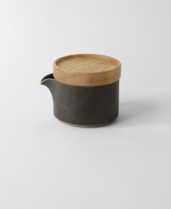 Black m odular glazed porcelain milk pitcher with dark charcoal color and soft sand texture.   HASAMI $44