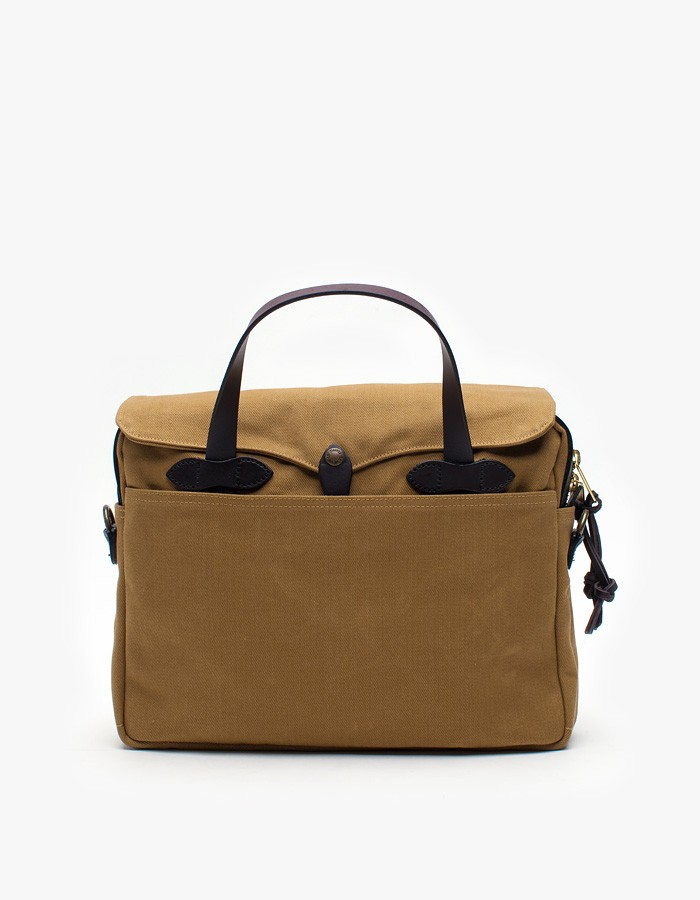 Original Briefcase in Tan   Original classic briefcase features wide interior carrying compartment, two full-length open pockets, utility compartments, narrow pockets on both ends and full-length outer pockets on both sides.  FILSON $265