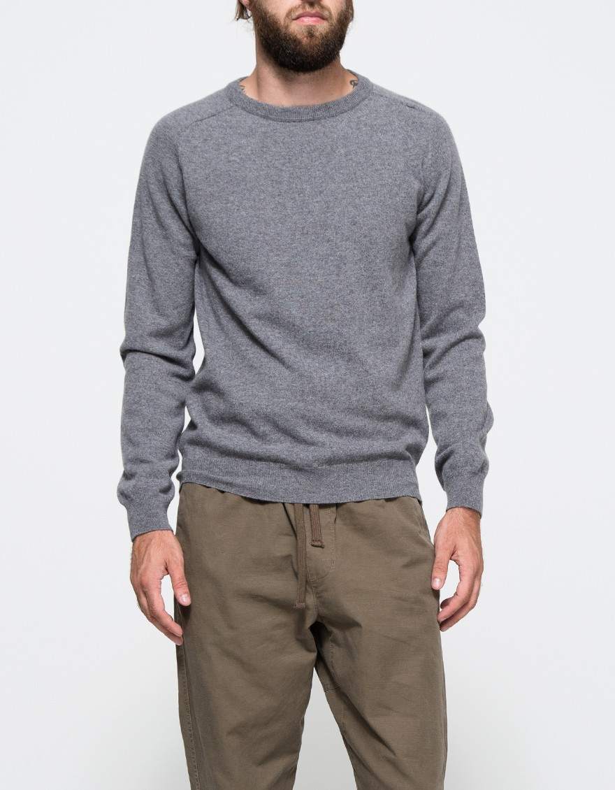 Carl Sweater   From A.P.C., a classic minimalistic mid weight wool pullover sweater in heather grey. Features rounded neckline, ribbed neckline, sleeve and hem, shoulder stitch detail and relaxed fit throughout.  APC $265