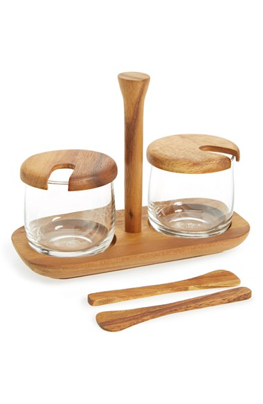 Add a touch of rustic refinement to your countertop or table with a set of glass jars in a handcrafted acacia wood tray, perfect for serving salt, pepper and other seasonings.   BE HOME $35