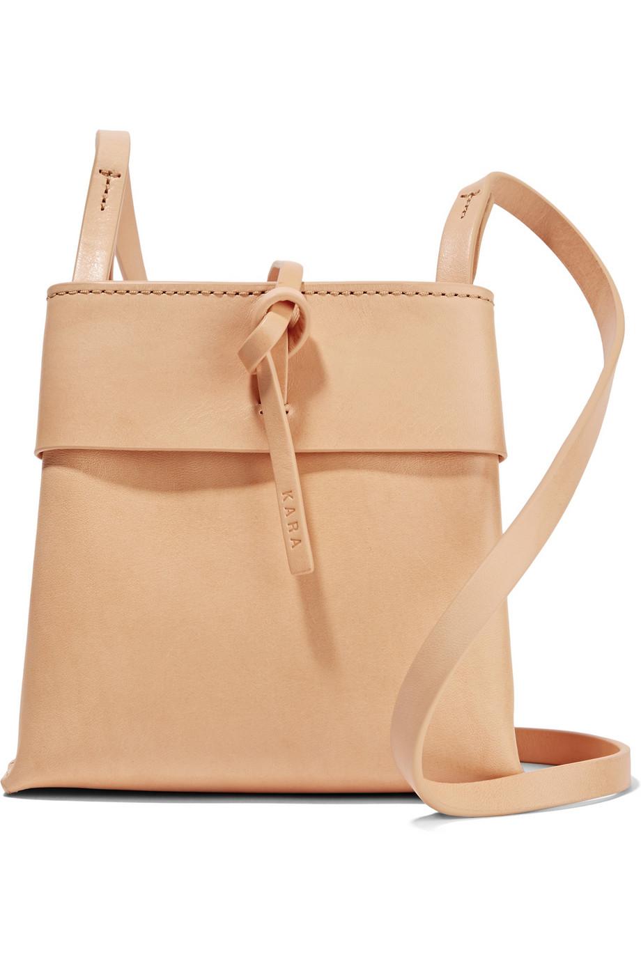 Nano Tie Shoulder Bag   Sleek vegetable tanned nano tie leather shoulder bag with a tie fastening at the top.  KARA $350