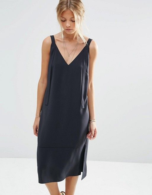 ASOS Slip Dress  Black dungaree style slip dress. Lightweight woven fabric with loose strap detail and split hem.