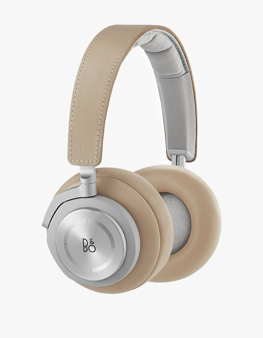 B&O PLAY H7 in Natural  Wireless over-ear headphones in Natural. Aluminium touch interface on right ear cup. Bluetooth connectivity. One electret type, Omni Directional microphone. Replaceable and rechargeable Lithium-Ion battery. Includes extra battery.