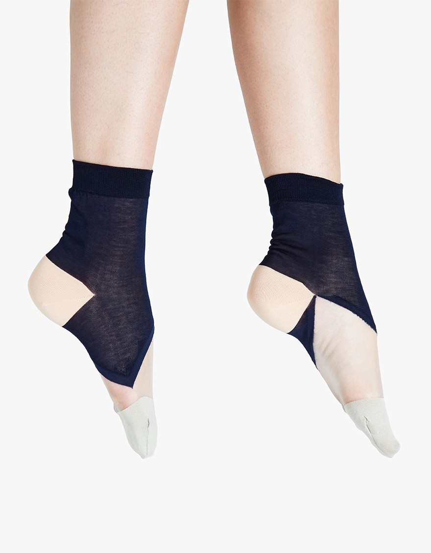 HANSEL FROM BASEL Lucid Sheer Short Crew  Contemporary crew socks from Hansel From Basel. Available in Leaf or Navy. Colorblock design. Ribbed cuff. Structured toe and heel.