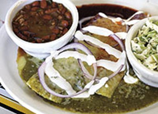 Chicken Yucatán and Beef Barbacoa Enchiladas served Christmas style  Photo:  Kaitlyn Iserman, Charleston City Paper