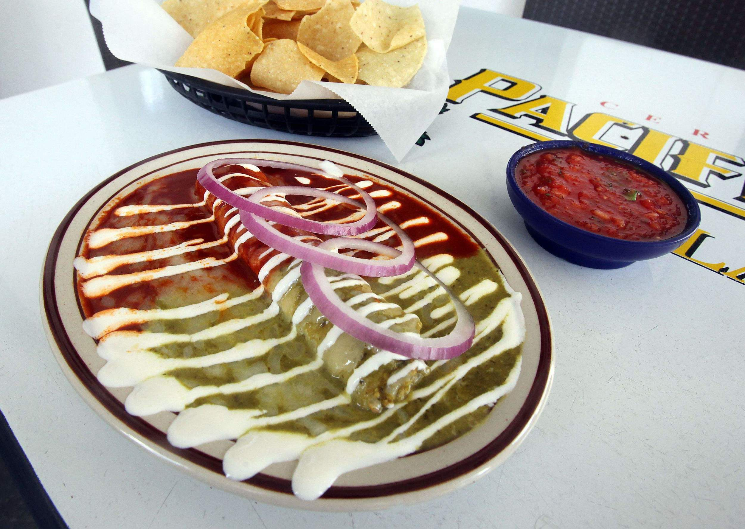 """An enchilada drizzled with crema at Zia Taqueria on James Island."" –  Hanna Raskin, The Post and Courier   Photo:  Brad Nettles, The Post and Courier"