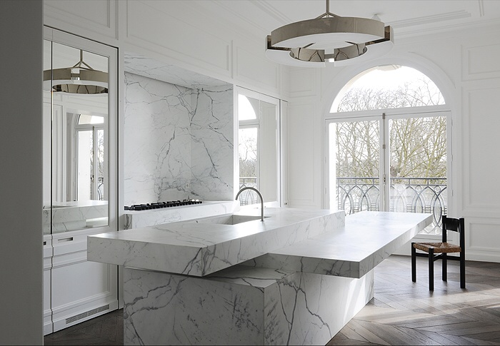 Stunning double glass doors overlooking an ornate marble kitchen island bench and copper pendant.