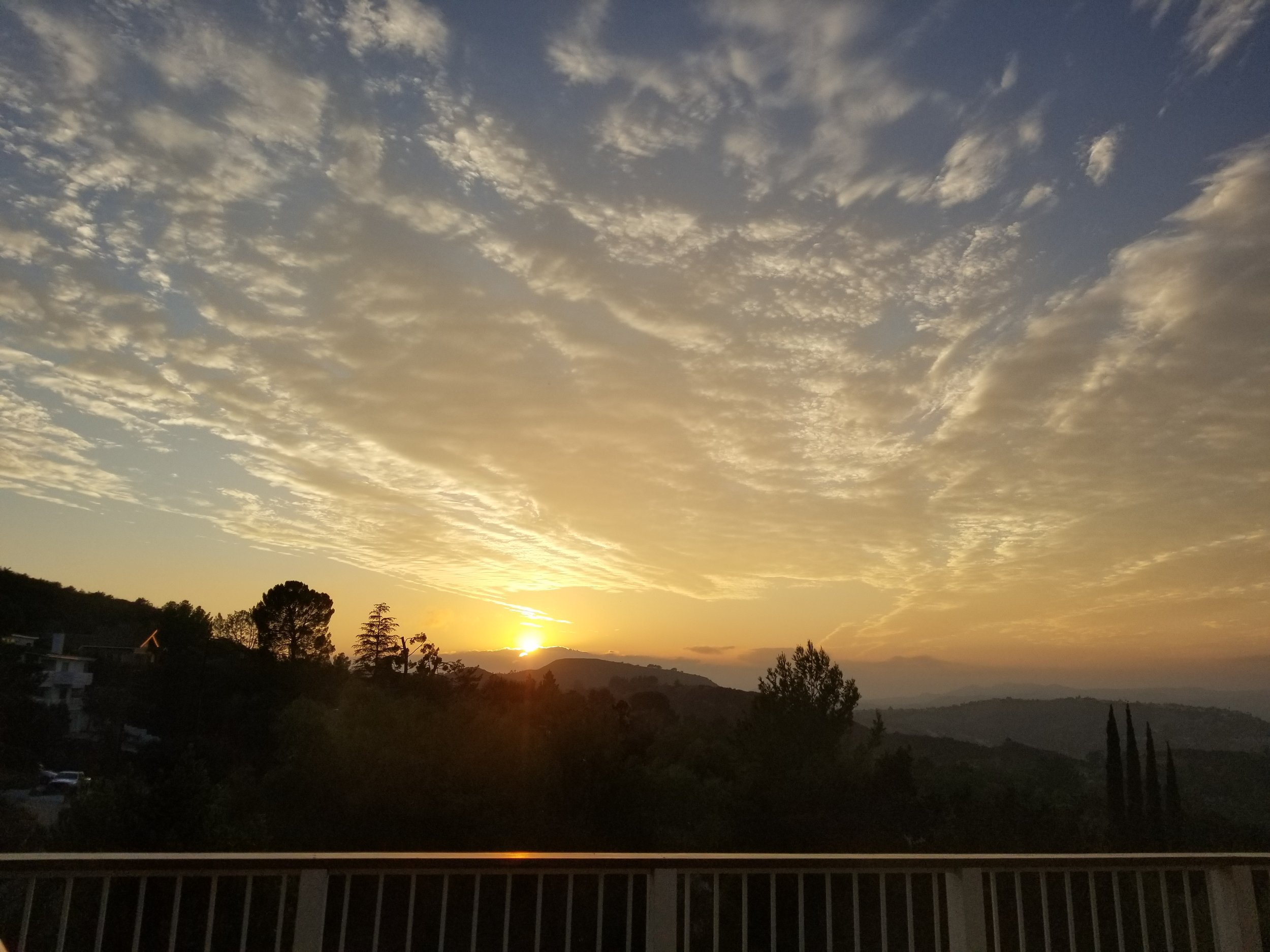 One of the many breathtaking sunsets from Halelly's back deck in Cali...