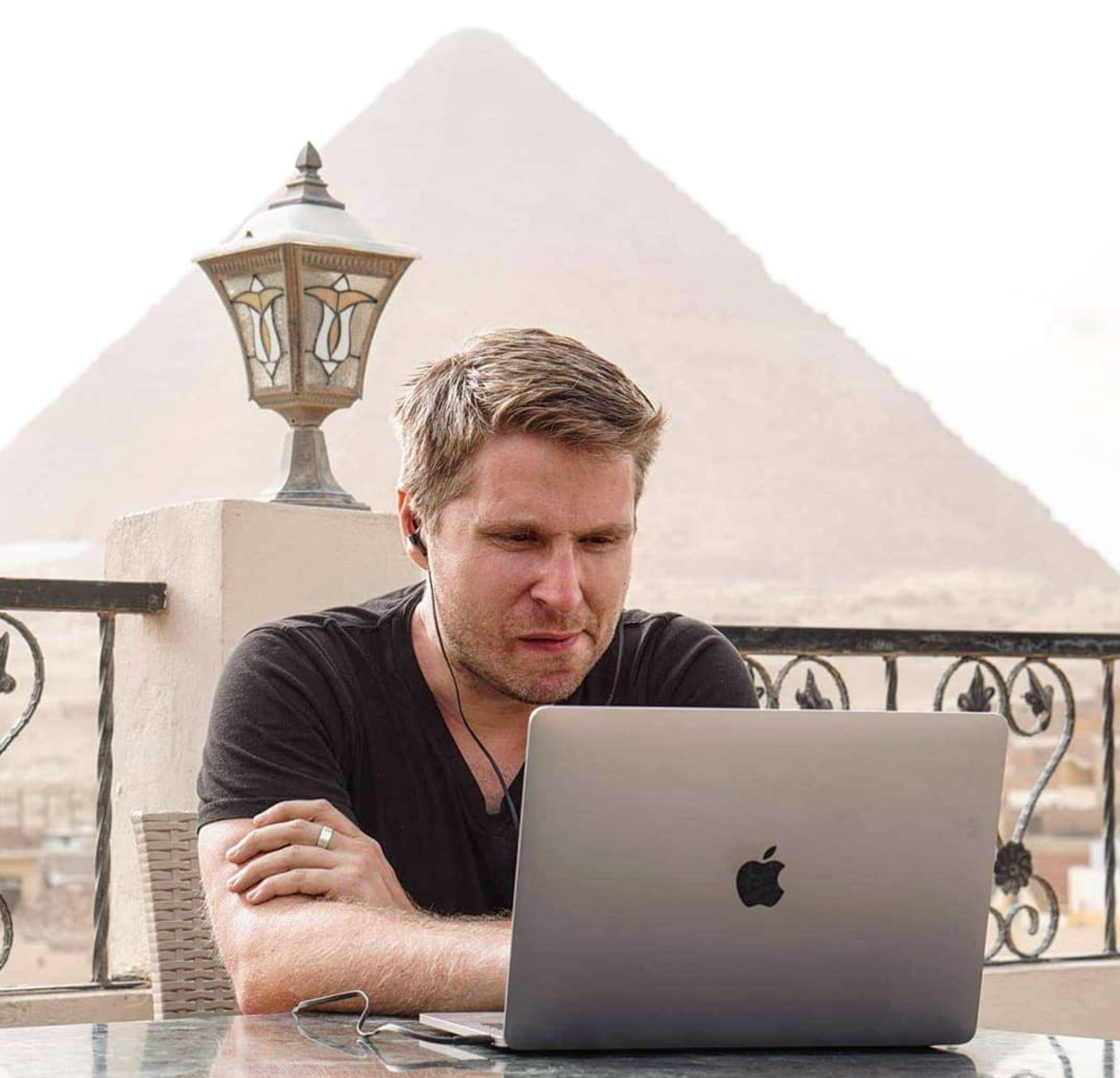 Here's Liam hard at his remote work in Egypt, with the Giza Pyramid as his backdrop. Photo courtesy Liam Martin. Listen to his remote work tips on ep144 of the TalentGrow Show podcast with Halelly Azulay.