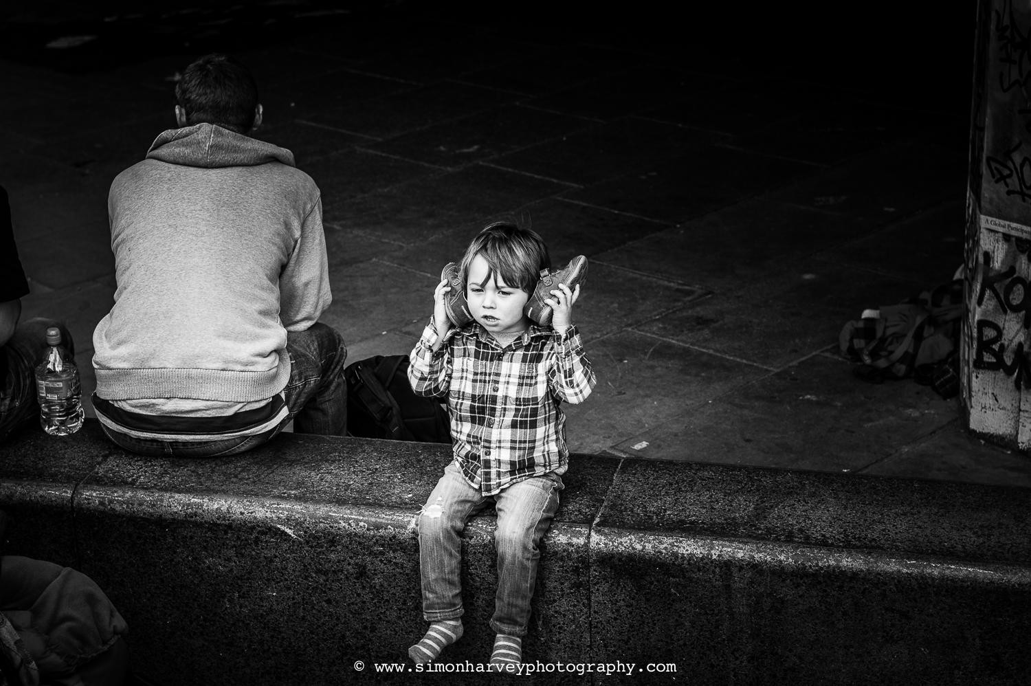 Young boy on Southbank having fun in his imaginary world...
