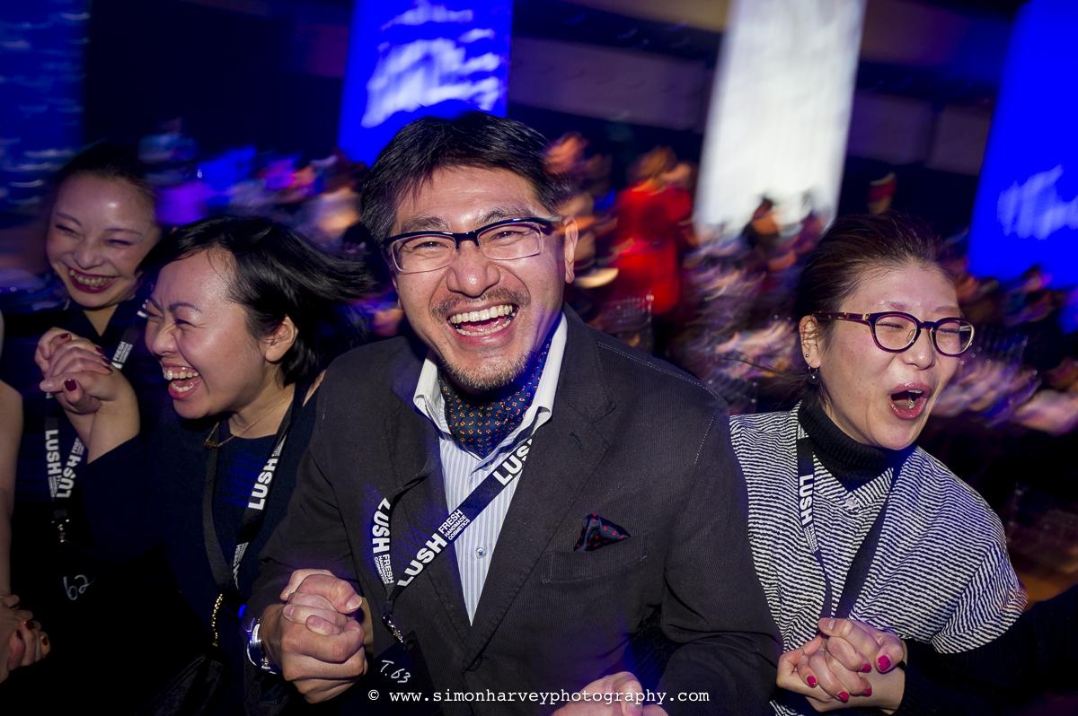 smiling_japanese_man_at_party.jpg