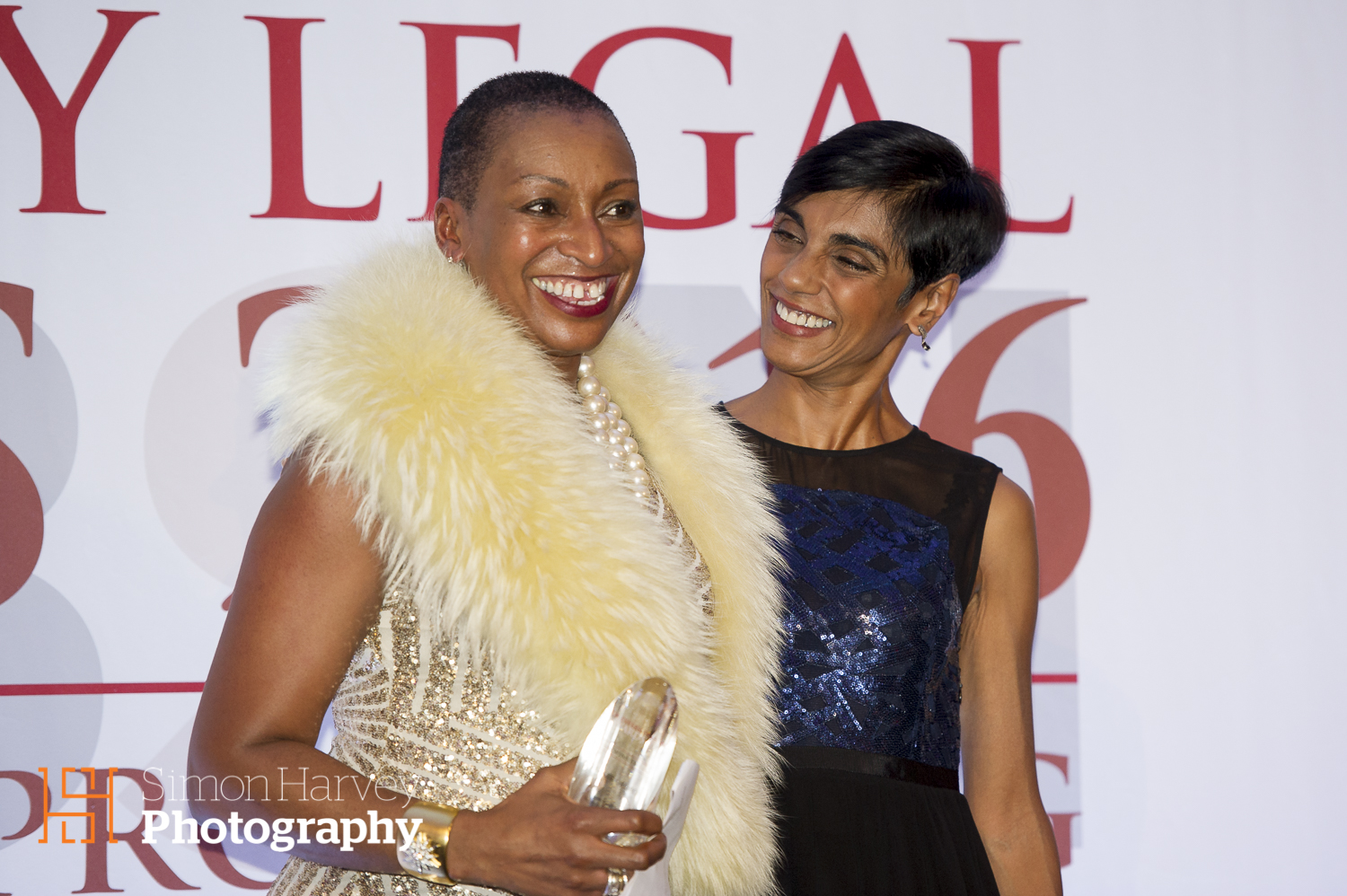 Sandie Okoro  receiving her Lifetime Achievement award from Reeta Chakrabarti.