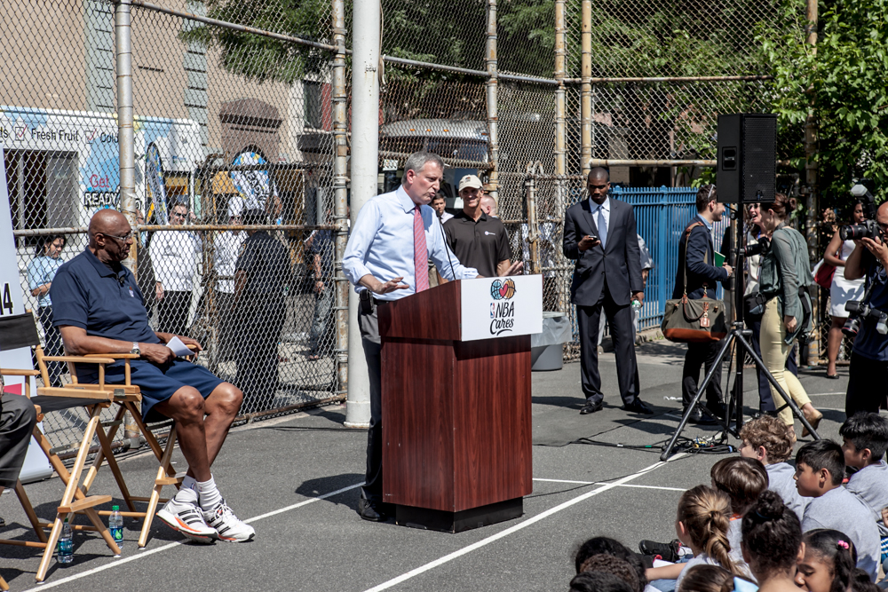Bill de Blasio, Mayor of New York City, gives a speech to kids, players and media at PS 111 on Draft Day.