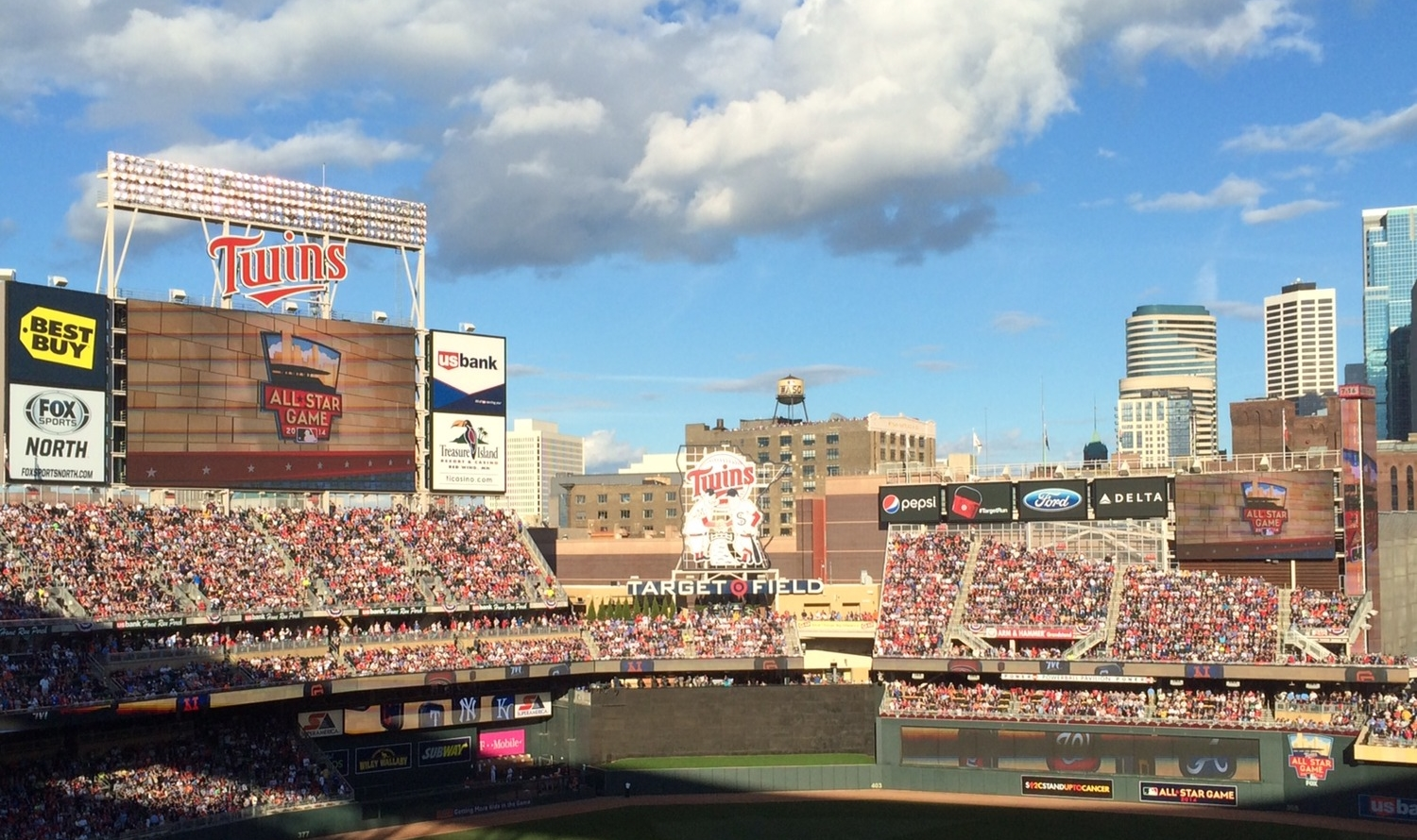The Minneapolis architecture, blue sky, and clouds match the 2014 ASG logo perfectly.