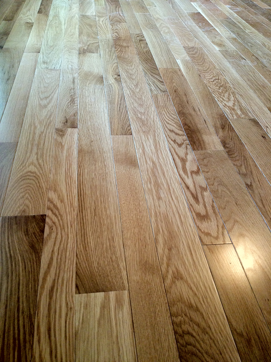 Solid wood flooring in kitchen and dining area.