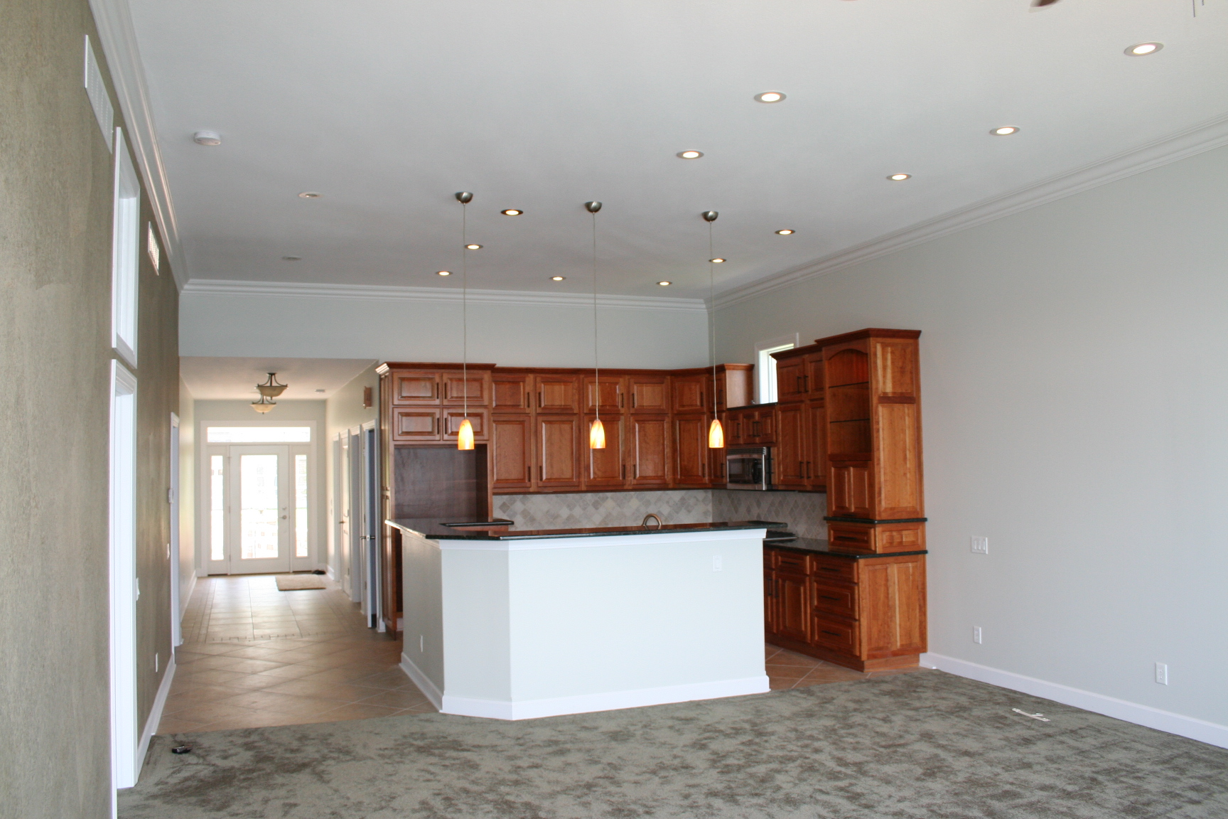 Custom built cherry cabinets with natural finish.