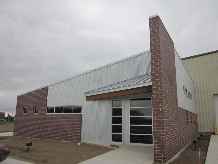Built office building onto front of metal framed factory.