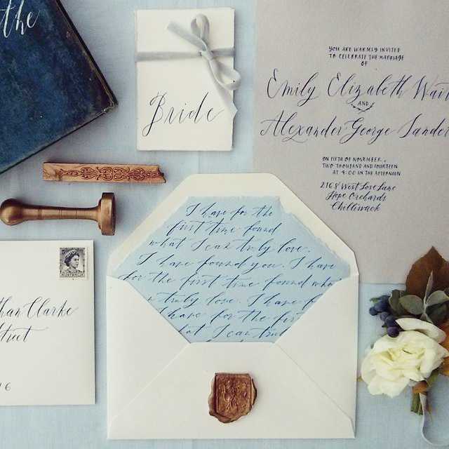 Calligraphy and Design by  Fox and Flourish |  Invitation, envelope liner, wax sealfrom Paper-Ya, flowers by  Celsia Floral  | Photo by Tahnee Sanders