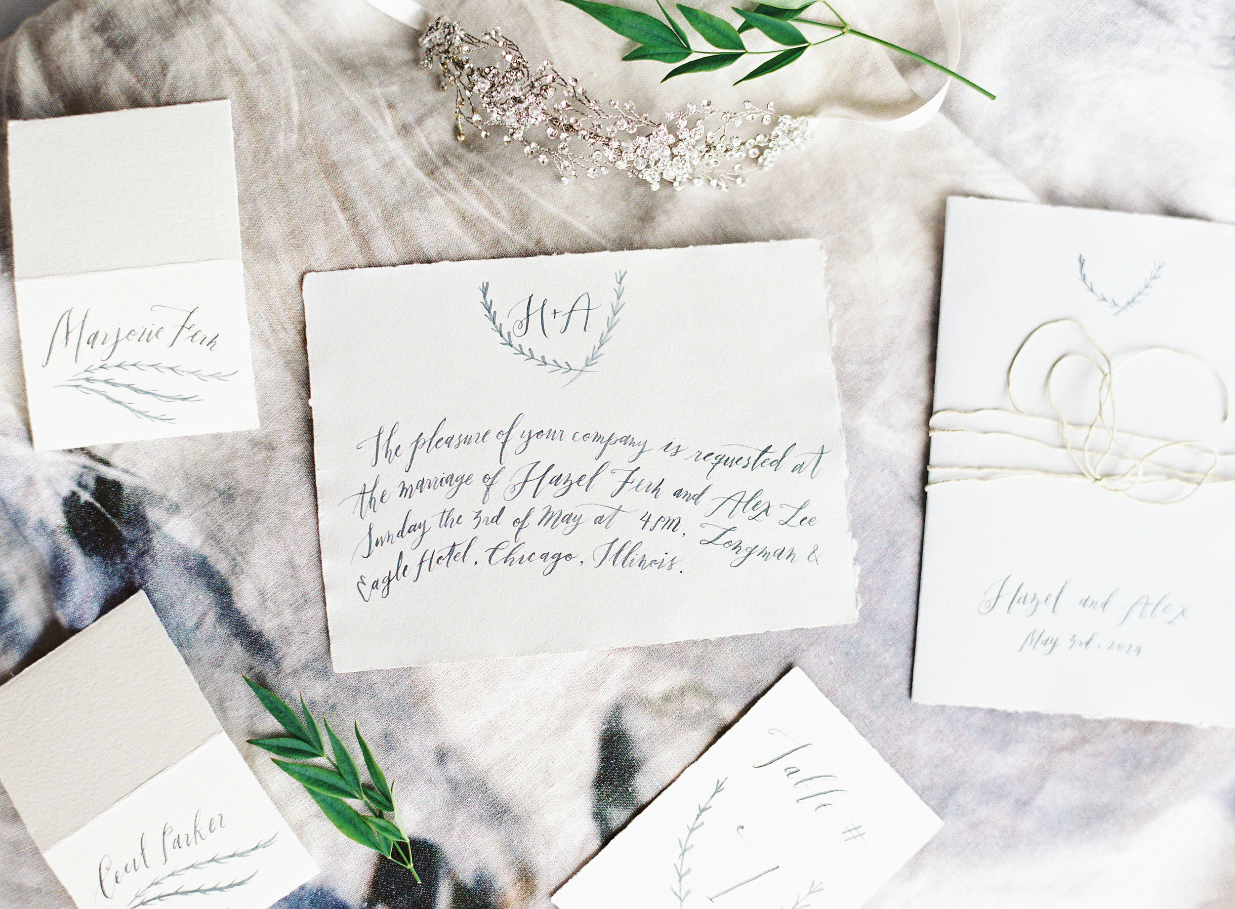 Photo by  Corinne Krogh Photography . Calligraphy by  Fox and Flourish .All handmade paper from Paper-Ya.