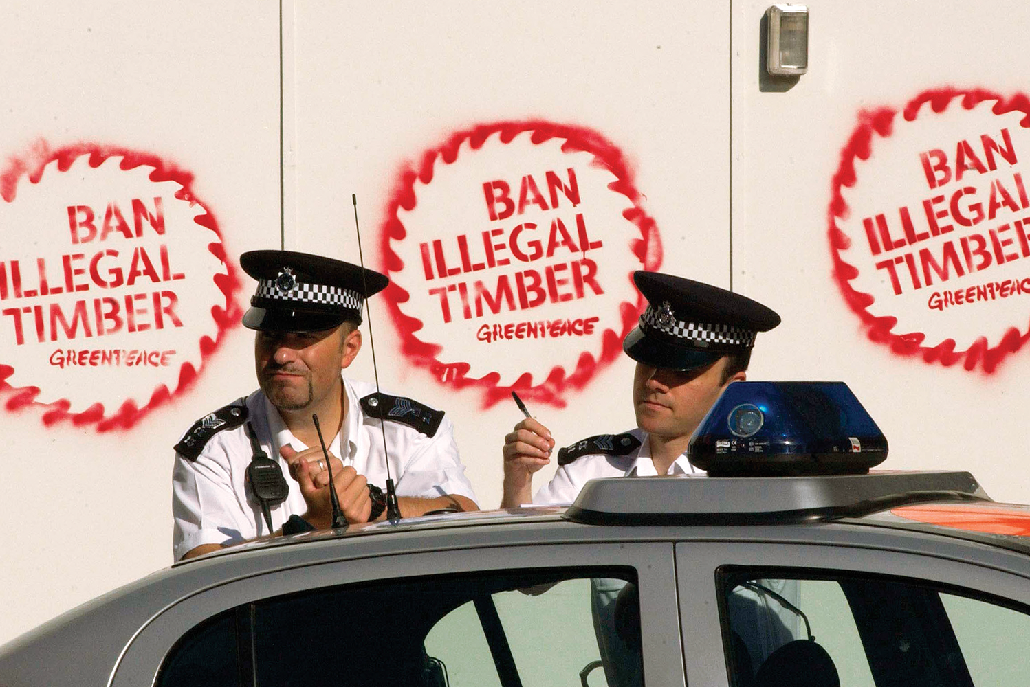 Campaign_Greenpeace_BanIllegalTimber_Stencil_Police.png