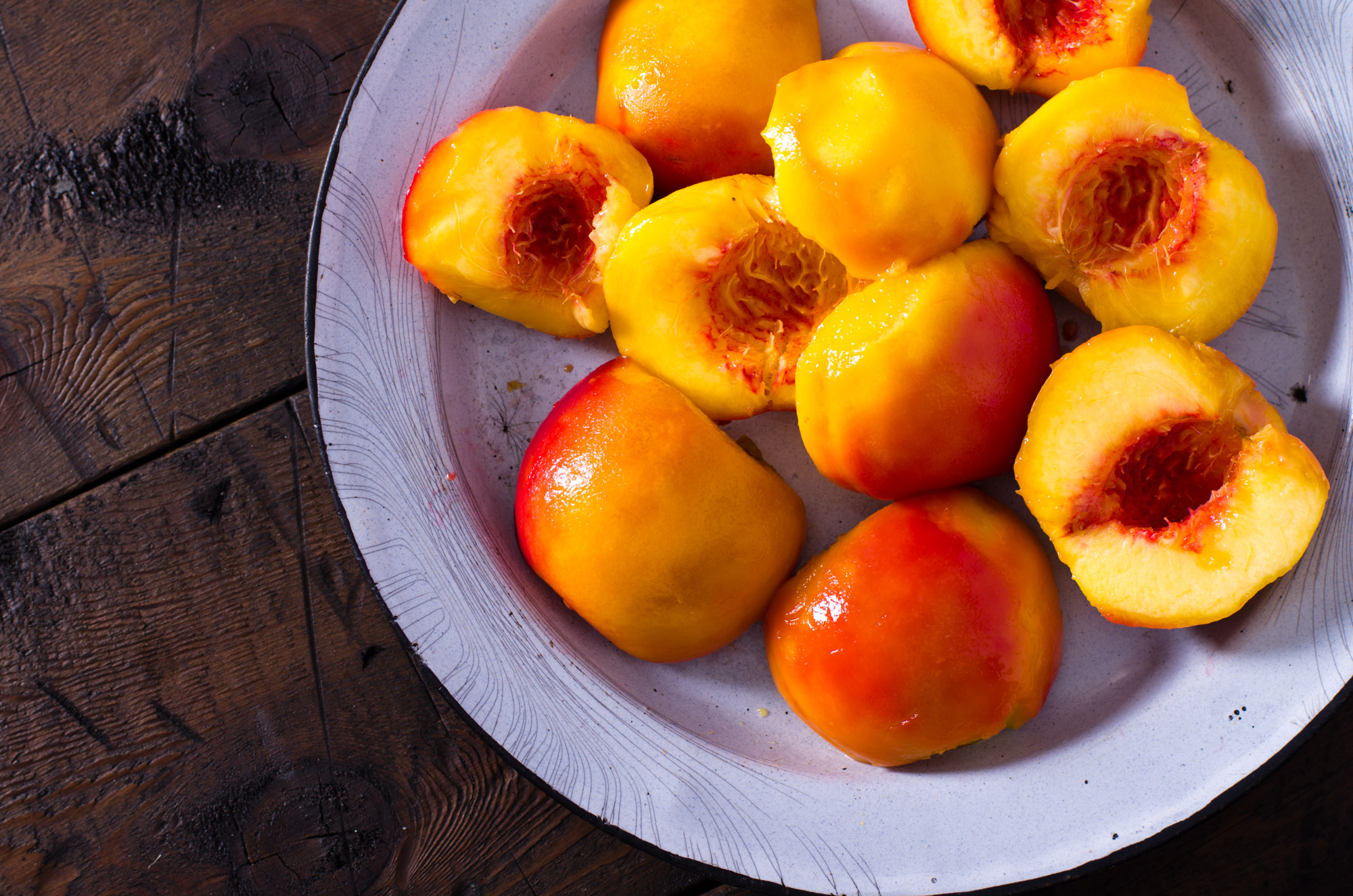 Poached peaches in rustic dish