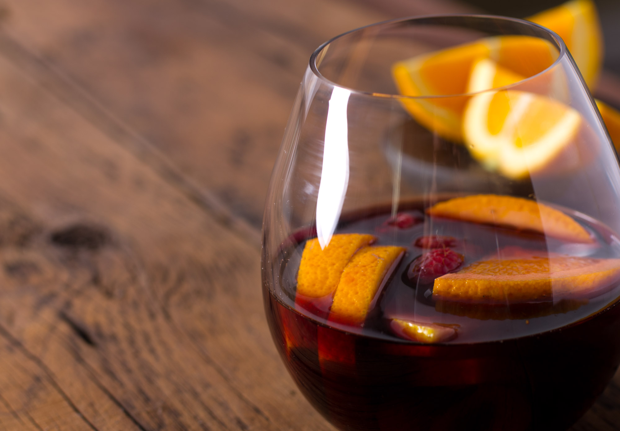 Sangria with orange slices and berries
