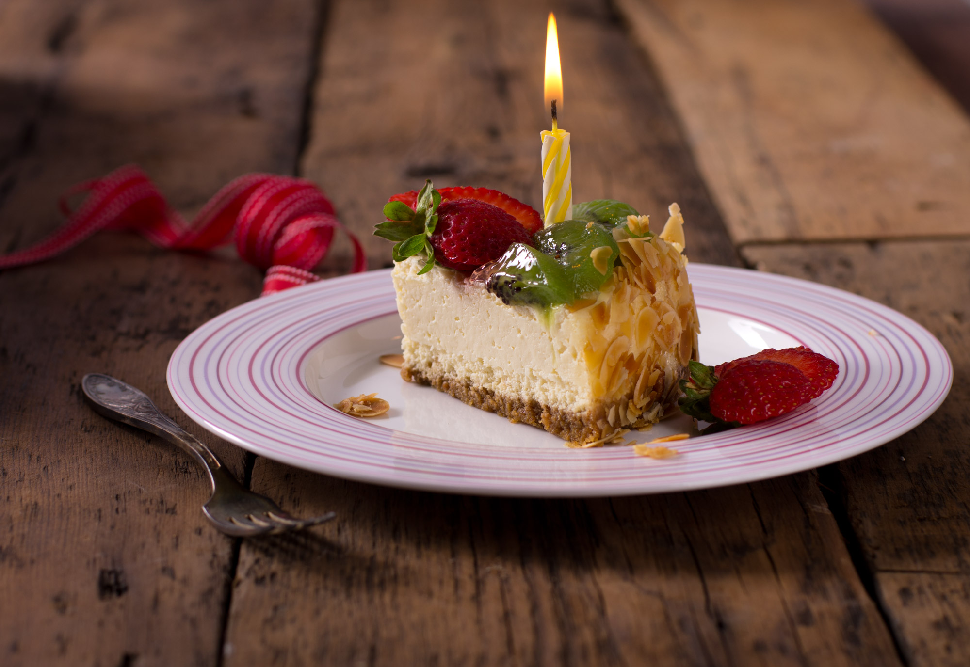 Fruit cheesecake with birthday candle