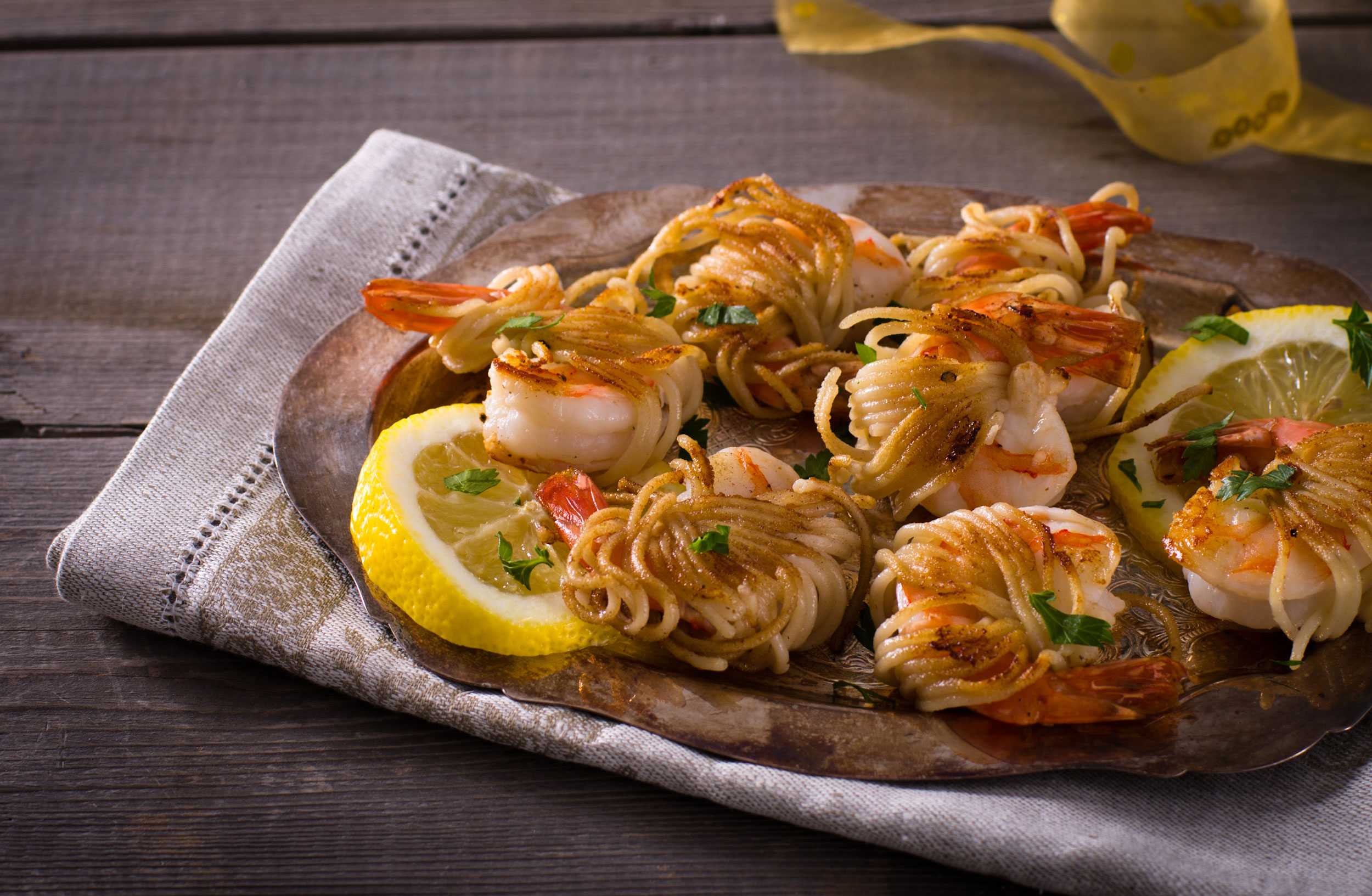 Spaghetti wrapped shrimp